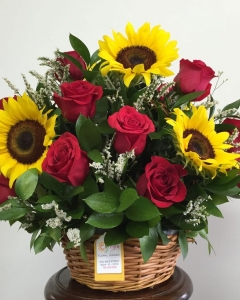 Basket of sunflowers and red roses